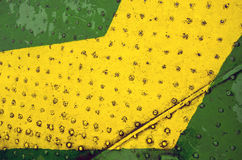 Green yellow paint metal floor closeup background Royalty Free Stock Image