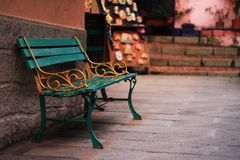 Green and yellow painted bench in Manarola. National Park of Cinque Terre, Ligury, Italy stock image