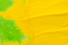Green and yellow painted crepe paper background Royalty Free Stock Photos