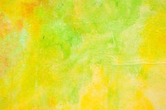 Green and yellow painting on the wall texture. Closeup of green and yellow painting on the wall texture stock photo