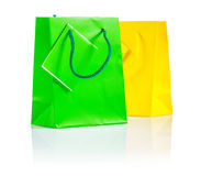 Green and yellow paper bags isolated Stock Photography