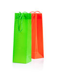 Green and yellow paper bags  on white Royalty Free Stock Photo