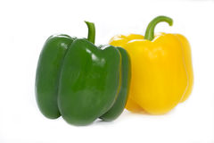 Green and yellow Paprika peppers Stock Images
