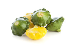 Green and Yellow Pattypan Squashes Isolated Stock Images