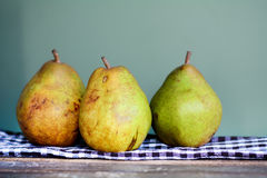 Green and yellow pears on a kitchen towel Royalty Free Stock Photo