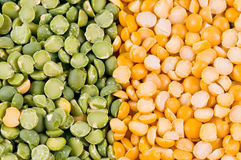 Green and yellow peas. As a background Royalty Free Stock Photos