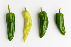 Green and yellow peppers on white background Royalty Free Stock Image