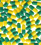 Green and yellow pills Stock Photography