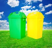 Green and yellow plastic trash recycling container ecology conce Royalty Free Stock Photos