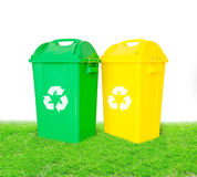Green and yellow plastic trash recycling container with recycle Royalty Free Stock Photography