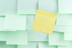 Green and yellow post-it note Stock Photo