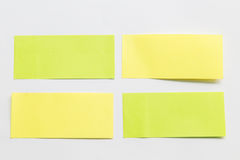 Green and yellow post it paper note on white background.  Royalty Free Stock Photography