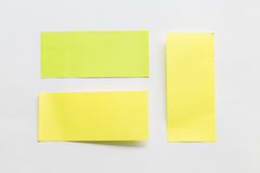 Green and yellow post it paper note on white background.  Stock Images