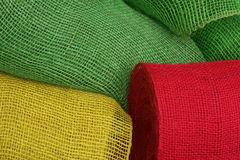 Green, yellow and red. Bales of jute in three different colours, green, yellow and red Stock Photography