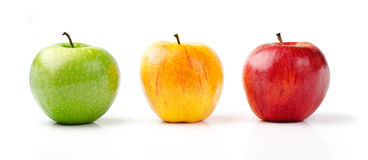 Green, Yellow and Red Apples Stock Images