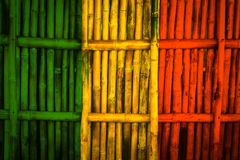 Green yellow red on bamboo , reggae background concept