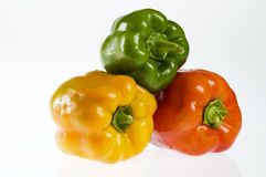 Green, yellow and red bell peppers Royalty Free Stock Image