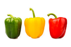 Green, yellow and red bell peppers Stock Images