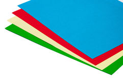 Green, yellow, red and blue papers for origami Royalty Free Stock Image