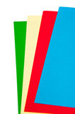 Green, yellow, red and blue papers for origami Stock Photos