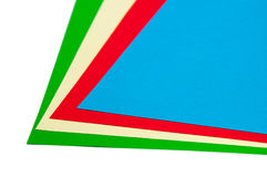 Green, yellow, red and blue papers for origami Royalty Free Stock Photos