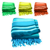 Green, yellow, red and blue towel Stock Images