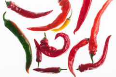 Green, yellow and red chili peppers isolated on white background. Green, yellow and red chili pepper isolated on white background. Closeup image of ideal hot Stock Image