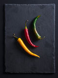 Green, yellow and red chilli peppers Royalty Free Stock Photo