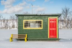 Green Yellow Red Ice Fishing Cabin Stock Photography