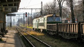 Two electric cargo locomotives ET22 with cargo carriage in Cesky Tesin in Czechia. Green, yellow and red livery of cargo train waiting for clearence in Cesky Stock Photography