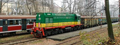 Diesel loco TEM-2 operated by PTK Holdind SA Zabrze in Cieszyn rail terminal in Poland. Green, yellow and red livery of diesel engine powered, cargo locomotive stock photos
