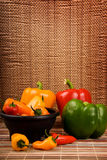 Green yellow red and orange bell peppers Royalty Free Stock Photo