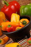 GREEN YELLOW RED AND ORANGE BELL PEPPERS Stock Photography