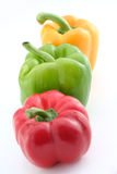 Green yellow and red peppers. On a white background royalty free stock images