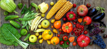 Green, yellow, red, purple fruits and vegetables. On wooden background Stock Photo