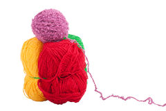 Green yellow red and purple skeins of wool isolated on a white b Royalty Free Stock Photo
