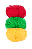 Green yellow red skeins of wool isolated on a white background Royalty Free Stock Photo