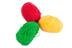 Green yellow red skeins of wool isolated on a white background. Royalty Free Stock Photography