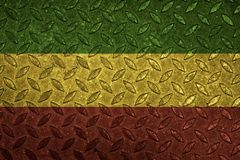 Green yellow red on steel plate, reggae background concept stock photos
