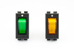 Green and Yellow Rocker Switches with Light Royalty Free Stock Image