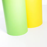Green and yellow rolls of cardboard Stock Image