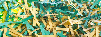 Green and yellow shredded paper. Some green and yellow shredded paper strips Royalty Free Stock Photo