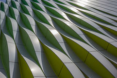 Green, yellow and silver curves of the university hospital in Gr Stock Photos