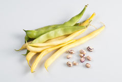 Green and yellow string beans. Over white background Stock Images