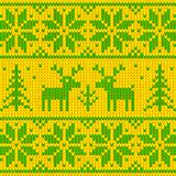 Green and yellow sweater with deer ornament Stock Photo