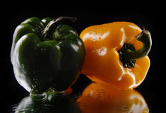 Green and yellow sweet pepper  on a black background Stock Photography