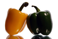 Green and yellow sweet pepper on a white background Stock Images