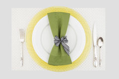Green and yellow table place setting Stock Photo