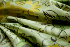 Green, yellow tender colored textile, elegance rippled material Stock Photography