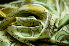 Green, yellow tender colored textile, elegance rippled material Stock Images